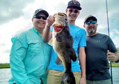 three-men-one-fish