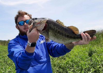 fisherman-with-horizontal-bass